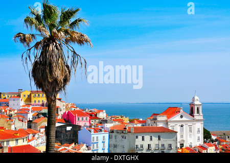 view of Alfama and the Tagus River from Miradouro de Santa Luzia in Lisbon, Portugal - Stock Photo