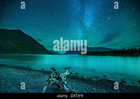 the Milky Way and night sky over Kathleen Lake & the St Elias Mountains, Kluane National Park, Yukon Territories, - Stock Photo