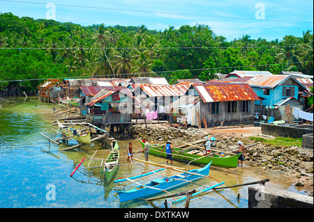 Fishermen in small boats in the philippines stock photo for Ocean isles fishing village