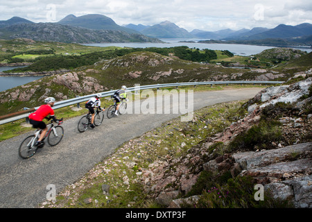 A cyclist takes on Britain's longest road climb in Lochcarron, Scotland - Stock Photo
