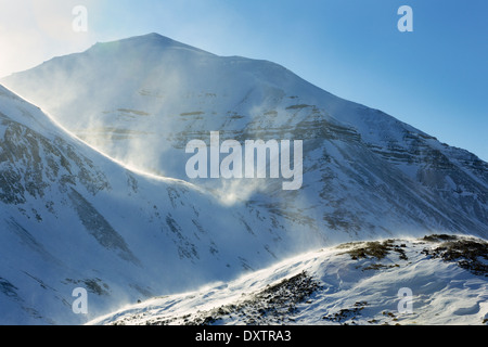 View on mountain range with snow and blizzard at Spitsbergen. Svalbard. - Stock Photo