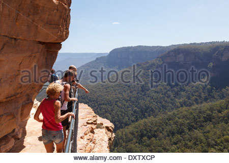 Walkers enjoying the view into Jamison Valley from the top of the Grand Stairway, Blue Mountains - Stock Photo