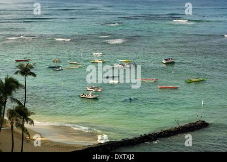 Boats in the water off Waikiki Beach; Honolulu, Oahu, Hawaii, United States of America - Stock Photo