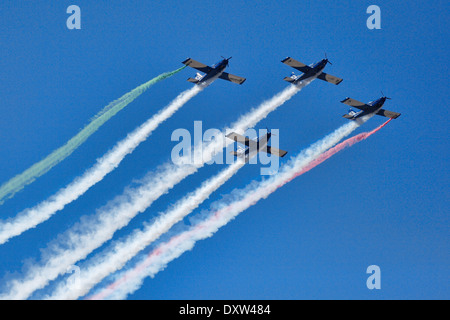 Aerobatic Airplane group formation during Air Show in Athens, Greece - Stock Photo