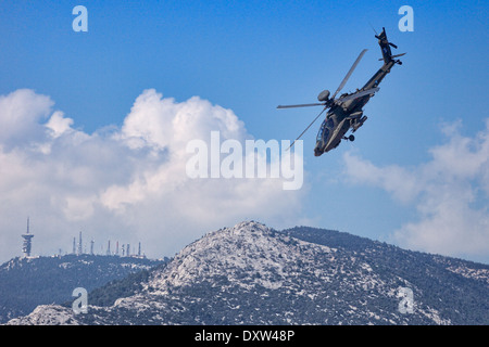 Apache helicopter aerobatic performance during Air Show in Athens, Greece - Stock Photo