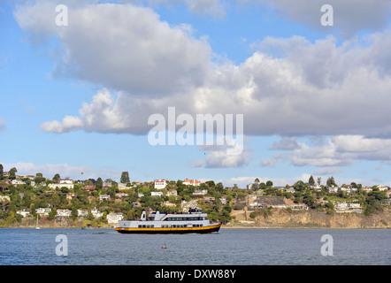 The Sausalito ferry sails along the Tiburon Penninsula in Marin County - Stock Photo
