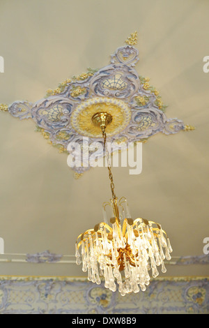A beautiful, ornate chandelier in the Turnblad mansion at the American Swedish Institute in Minneapolis, Minnesota. - Stock Photo