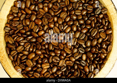 Coffee beans in a wooden barrel close-up. - Stock Photo