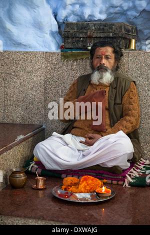 India, Dehradun. Hindu Sadhu (Holy Ascetic) in the Tapkeshwar Hindu Temple. - Stock Photo