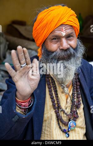 India, Dehradun. Tapkeshwar Hindu Temple. Sadhu, a Hindu Ascetic. He wears a mala (rosary) of rudraksh seeds. - Stock Photo