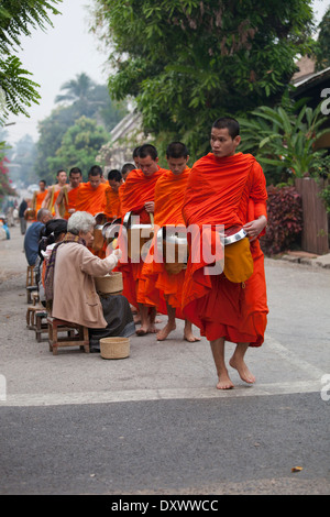 Buddhist Monks Morning Ritual, alms giving/ receiving 4 - Stock Photo
