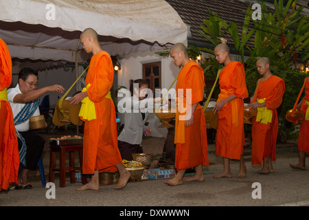 Buddhist Monks Morning Ritual, alms collection. - Stock Photo