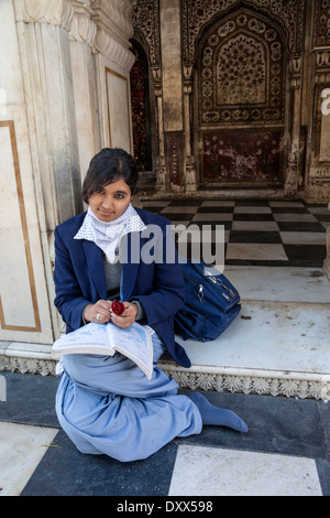 India, Dehradun. Young Female Student Studying at the Durbar Shri Guru Ram Rai Ji Maharaj, a Sikh Temple Built in - Stock Photo
