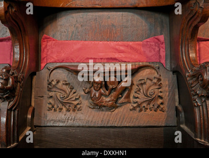 Close-up of a 15th century wooden choir stall with a misericord, depicting a mermaid, Carlisle Cathedral, Cumbria, - Stock Photo