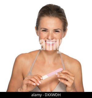 Happy young woman using nail file - Stock Photo