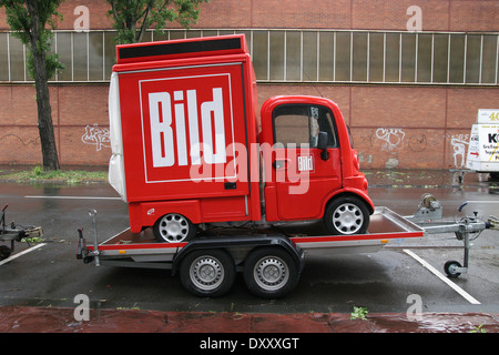 BILD logo on a short red car in Cologne, Germany. - Stock Photo