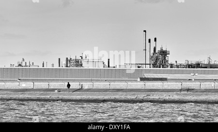 Chimneys of a factory in industrial area near Sheerness (black and white image) - Stock Photo