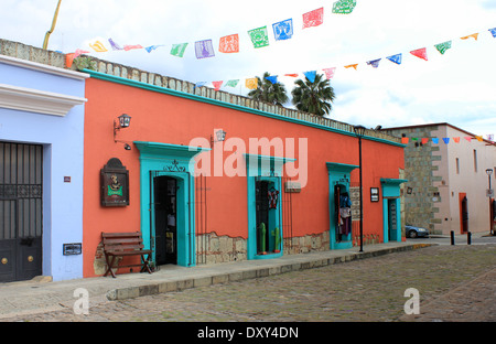 Colourful houses lining a cobbled street in Oaxaca, Mexico - Stock Photo