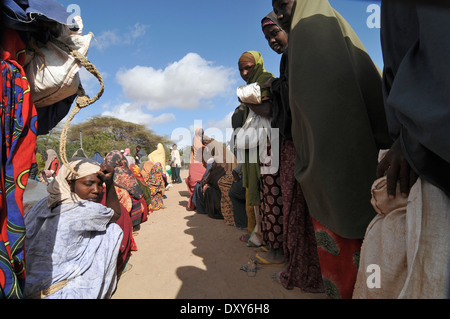 DADAAB, SOMALIA - AUGUST 7 Unidentified women and men live in the Dadaab refugee camp - Stock Photo