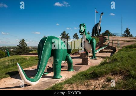 Apatosaurus, Triceratops, and Tyrannosaurus rex sculptures at Dinosaur Park. - Stock Photo