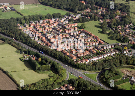 aerial view of modern housing estate, many houses have solar panels on the roof - Stock Photo