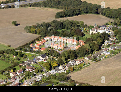 aerial view of a modern housing estate in green belt area - Stock Photo