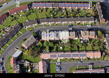 aerial view of modern and older houses and bungalows with solar panels on the roof - Stock Photo