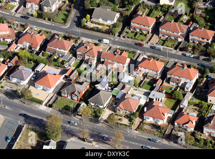 aerial view of bungalows with solar panels on the roof of a garage - Stock Photo