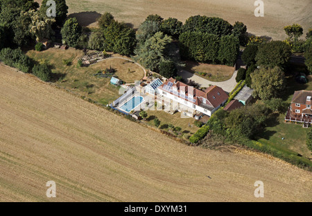 aerial view of modern housing with solar panels on the roof, expensive detached house with swimming pool - Stock Photo