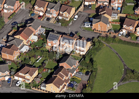 aerial view of modern housing with solar panels on the roof - Stock Photo