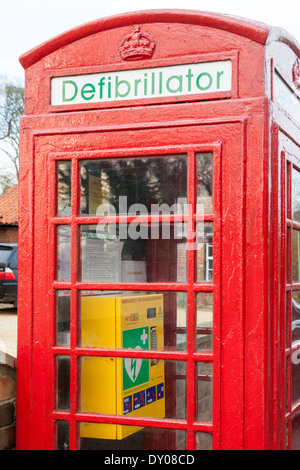 Defibrillator. Old telephone box now used to keep emergency life saving equipment in the community, Nottinghamshire, - Stock Photo
