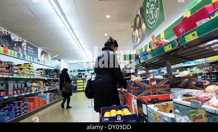 Chinese woman shopper shopping for fruit and vegetables in Lidl supermarket Cardiff Wales UK  KATHY DEWITT - Stock Photo