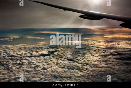 Flight flying over the clouds. Aerial shot from the sky. Emirates flight wing. - Stock Photo