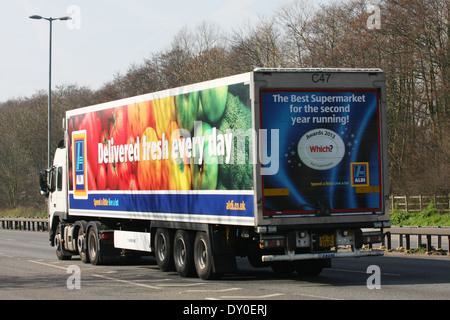 An Aldi truck traveling along the A12 dual carriageway in Essex, England - Stock Photo