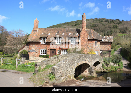 Picturesque old pack horse bridge over the Aller Brook at Allerford in Exmoor National Park North Somerset - Stock Photo