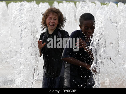 London, UK. 2nd Apr, 2014. Kids from London Chobham Academy School play in the fountains in the newly transformed - Stock Photo