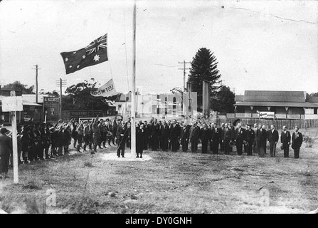 Mrs Charles Sharp unfurling the flag on Anzac Day, 25 April 1937, Coffs Harbour, NSW - Stock Photo