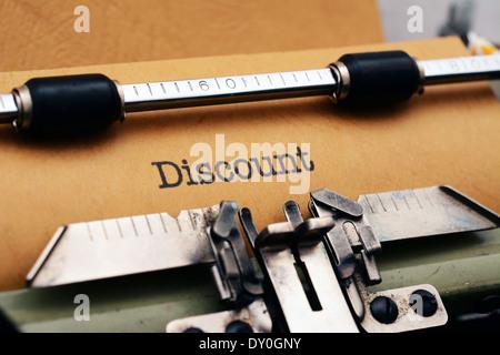 Discount text on typewriter - Stock Photo