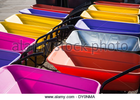 Colourful wheelbarrows - Stock Photo