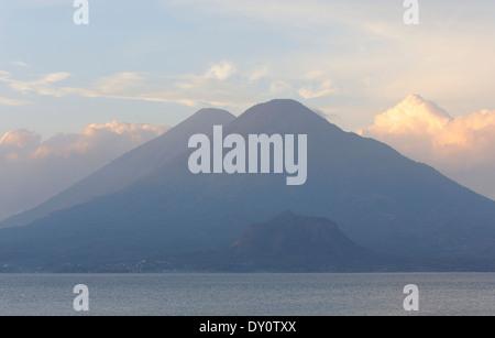 Early morning view across Lake Atitlan from Panajachel of  Volcan Toliman, 3153m, and, behind it,  Volcan Atltlan, - Stock Photo