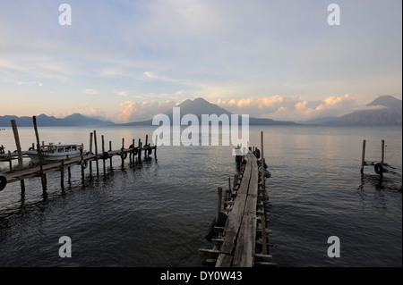 Early morning view across Lake Atitlan from Panajachel. To the left are Volcan Toliman, 3153m,   and, behind it, - Stock Photo