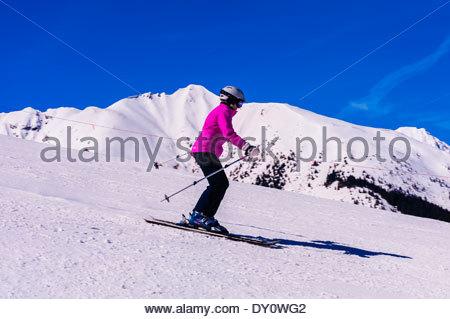 Skiers on Sneaky's (ski run), Aspen/Snowmass ski resort, Snowmass Village, Colorado USA. - Stock Photo