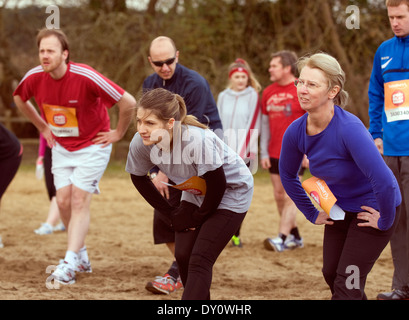 Volunteer runners for Sport Relief 2014 warming up prior to the race, Frensham, UK. - Stock Photo