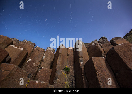 Starry night above the basalt columns at the Giant's Causeway UNESCO World Heritage site. - Stock Photo