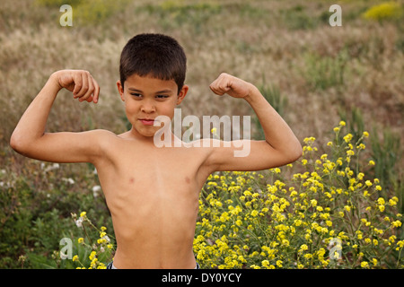 Playing in a field with my son... he was eight years old and a total country boy - Stock Photo