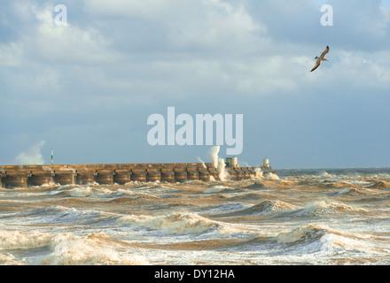 Stormy seas breaking over Brighton Marina, Sussex, UK - Stock Photo