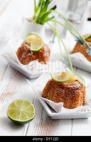 Bundt cake with lemon curd and lime slices - Stock Photo