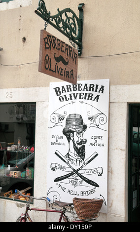 Amusing shop sign for the Barbearia Oliveira barber shop in the Alfama district of Lisbon, (Lisboa), Portugal. - Stock Photo