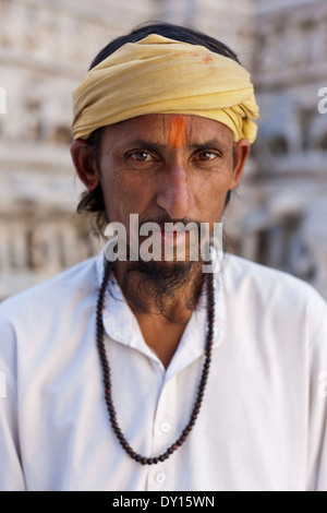 Udaipur, Rajasthan, India. Portrait of Sadhu on the grounds of the Jagdish Temple - Stock Photo