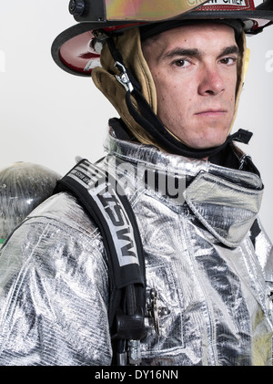 Male firefighter in high temperature aviation fuel   firefighting uniform with breathing apparatus - Stock Photo